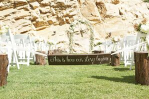 Wooden Aisle Sign and Tree Stump Aisle Decor