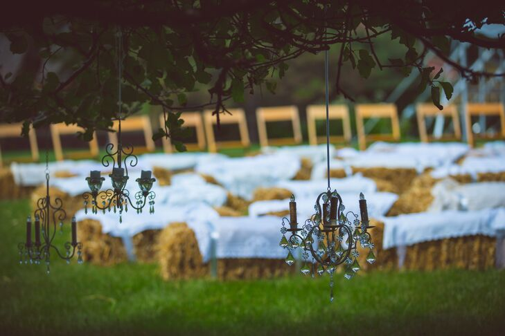 Guests got comfortable on folding chairs and bales of hay to watch Cheryl and John exchange vows in an outdoor ceremony on the farm's property.