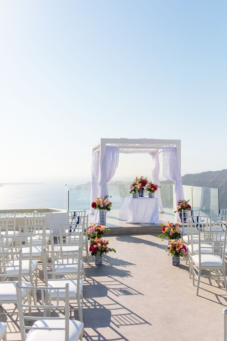 This waterfront wedding at Rocabella Hotel in Santorini, Greece,  drew inspiration from the bride's Chinese heritage and the groom's Greek roots. The