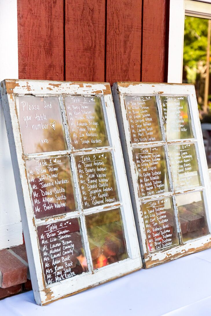 Guests found their seats at the reception using distressed white wood windowpanes: Each pane had a different table's number and names written in it. They loved how it fit the rustic theme.