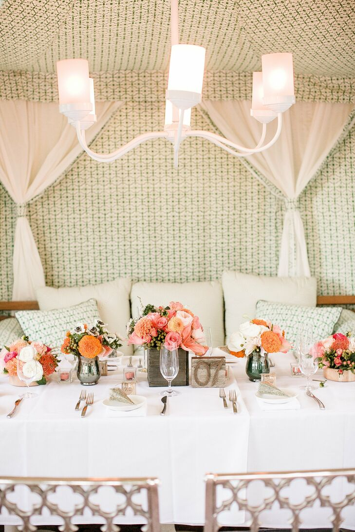 Floral arrangements were placed in wooden crates and gunmetal silver vases.