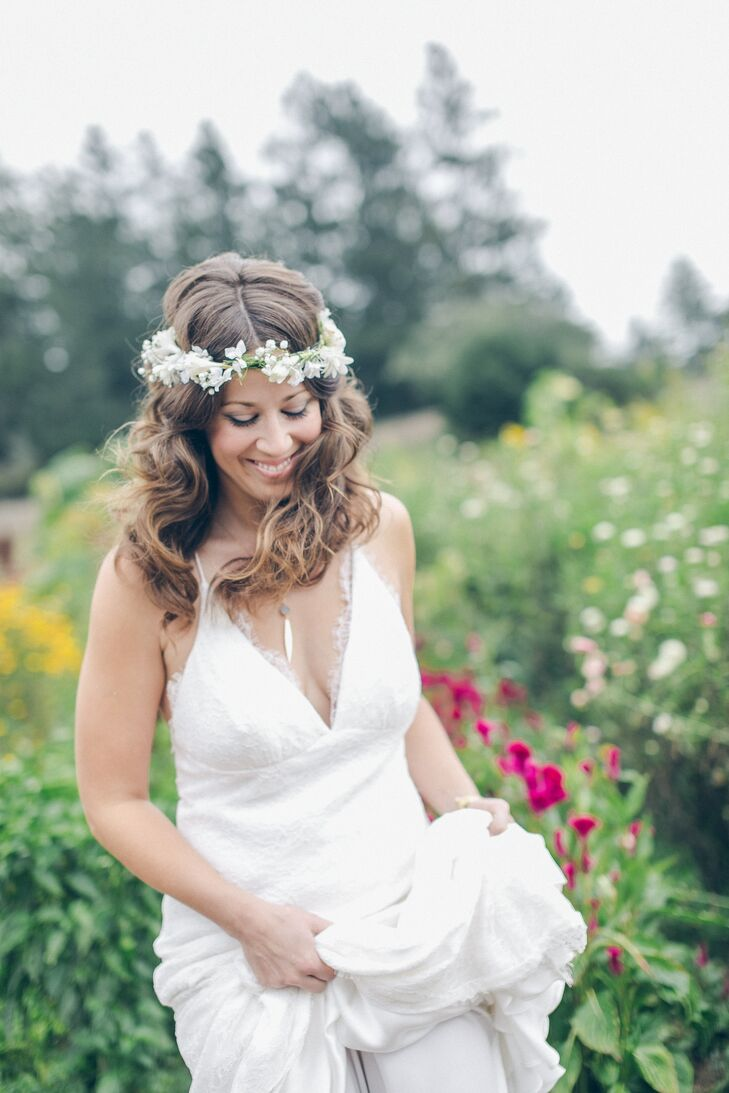 Jayme wore a flower crown made of white tuberoses on her head, which helped shape the bohemian look she envisioned. The crown went perfectly with the ivory V-neck dress accented in lace.