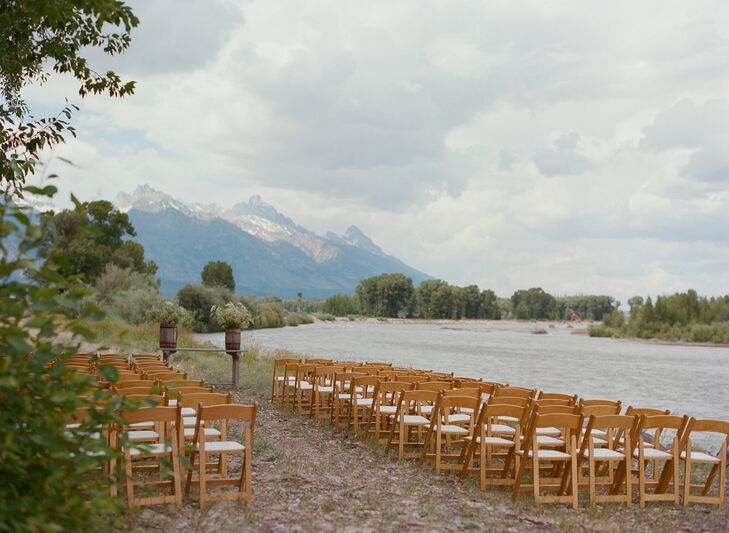 Chutney and Steve exchanged vows on top of the Wilson, Wyoming, ranch's levy overlooking the Snake River and the Grand Tetons. They created their stunning altar using a farm table topped with two wooden barrels filled with Queen Anne's lace.