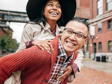 Happy couple piggyback ride