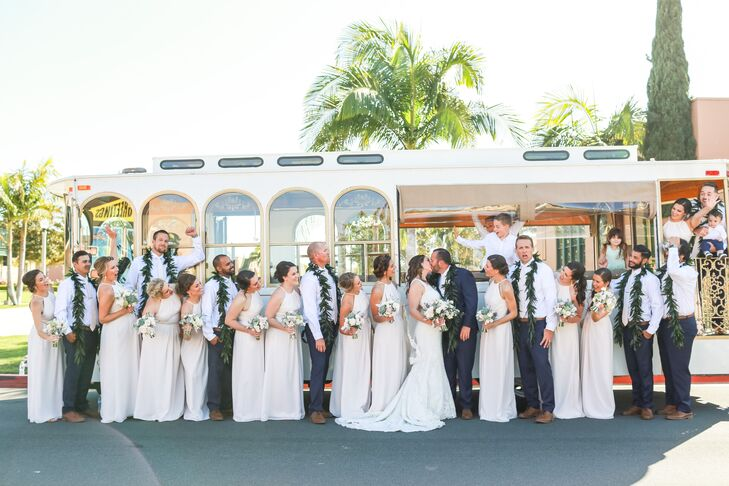 In lieu of boutonnieres, the men had maile ti-leaf leis to represent Hawaii, where Corey was born and raised. Corey's lei stood out from the others —it was made with orchids as well as maile ti leaves.