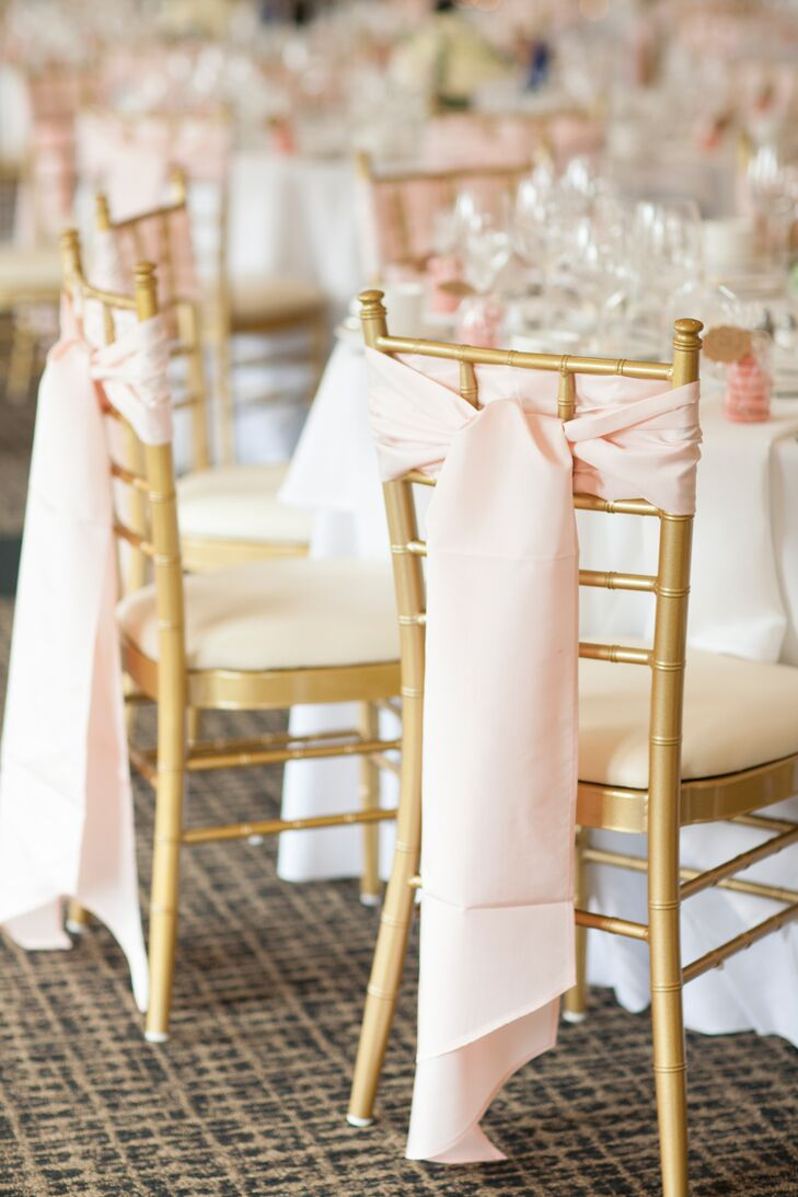 Gold chiavari chairs were accented with pale pink sashes for a romantic, elegant feel.