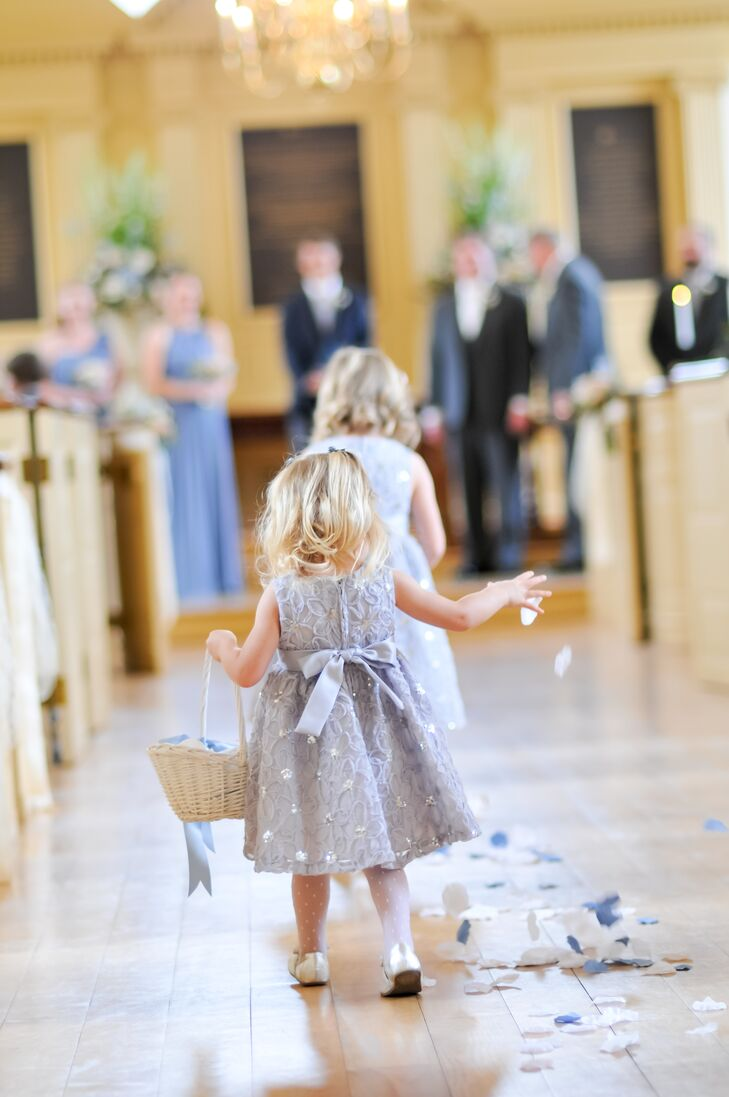 7350b210437 The couple s flower girls stood out from their blue and gray wedding party  with a fun
