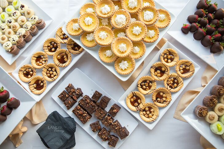 Guests could choose sweets from a dessert bar. As a fun treat, the couple also arranged for a french fry bar during their reception.