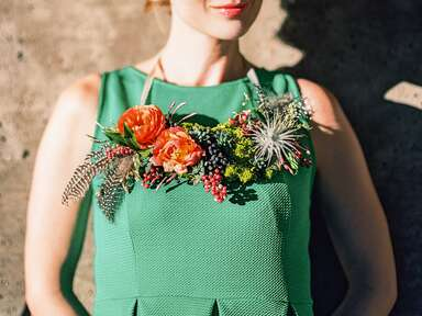 Flower necklace with ranunculus, greenery, and succulents