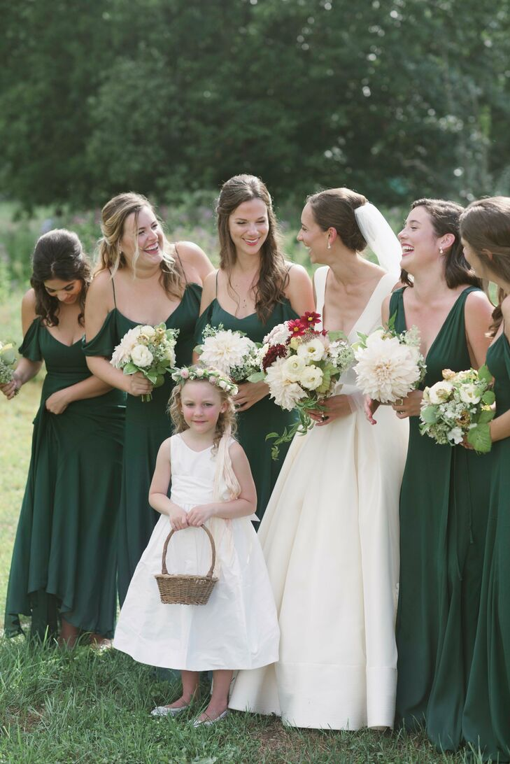 Taking cues from the natural landscape surrounding Blooming Hill Farm, Michele had her bridesmaids don ethereal floor-length gowns from Reformation in a dramatic shade of dark green. The girls paired the dresses with romantic half-up hairstyles and natural-looking makeup.