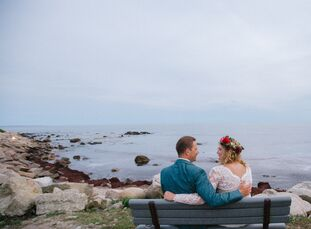 Tryn Collins (30 and an artist and teacher) and Matthew Kaelin (34 and a photographer) planned a romantic seaside wedding with rustic, romantic flair