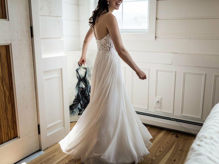 Bride wearing ivory wedding dress