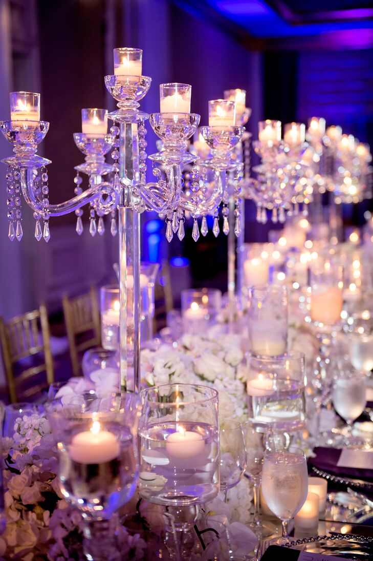 Tables were topped with arrangements of ivory hydrangeas, roses, orchids and stock, along with an array of romantic candelabras, votives and floating candles.