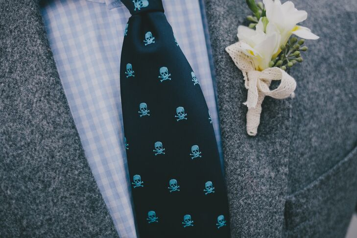 The groom wore a J.Crew suit jacket, pants from Frank and Oak and shoes by Suit Supply. A personal finishing touch? His navy and light blue skull-and-crossbones tie from Mango.