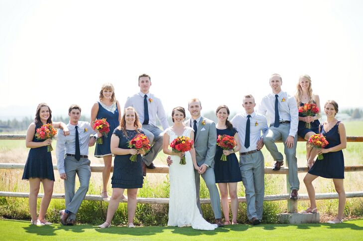 """""""Since our wedding was outdoors, we wanted our attire to be somewhere between casual and formal,"""" the couple says. """"We liked the idea of navy blue and light gray, and we could find flowers that would really pop."""""""