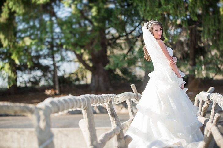 Jacquie wore a Maggie Sottero gown layered with lace with a beautiful bow at the back.