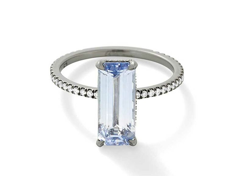 Elongated emerald-cut light violet sapphire engagement ring with blackened gold setting
