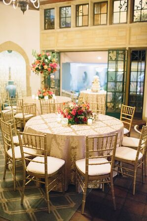 Gold-Filled Reception with Chiavari Chairs, Patterned Linens, Votives and Pink and Orange Arrangements