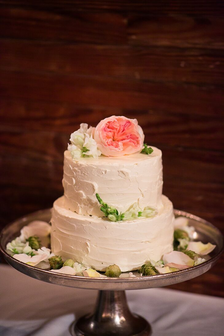 More than a few desserts were available for Caitlin and Mike's 190 guests in Laudholm Farm's barn. The couple chose a two-tier confection topped with a blush pink garden rose. They also served mini cupcakes and tartlets in different flavors. After dessert, the couple finished their night by dancing to a live band.