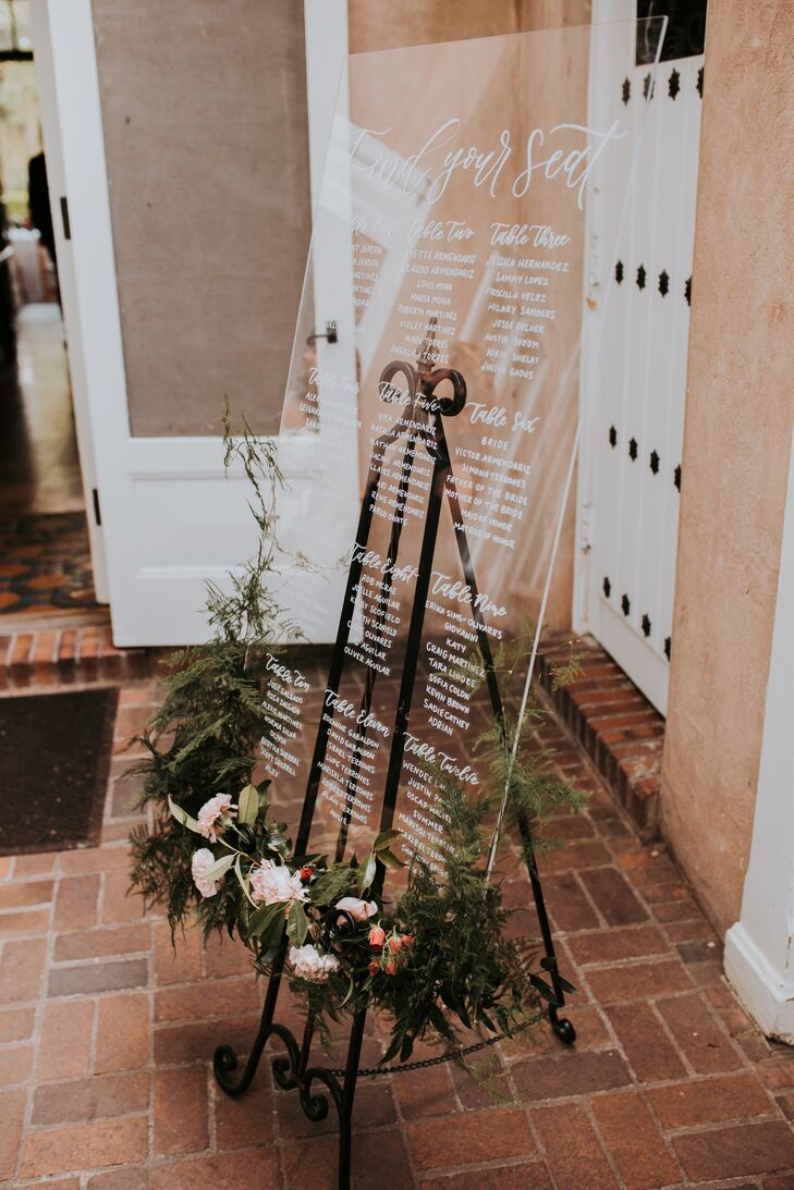 Elegant Acrylic Seating Chart on Easel with Greenery
