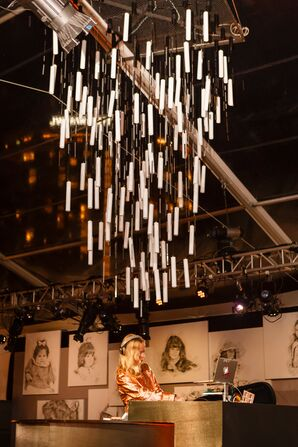 DJ with Whimsical Hanging Candle Installation