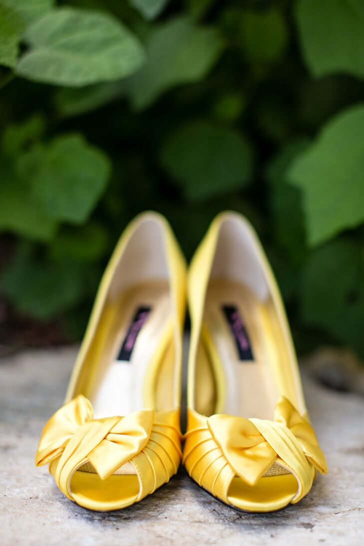 A pair of cheery canary-yellow, peep-toe pumps peeked out from the bottom of Claire's Nicole Miller gown.