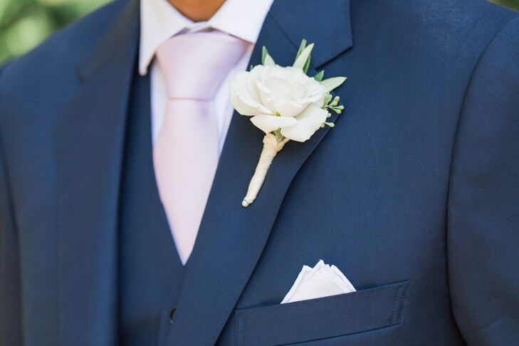 Gautum sported a deep navy suit, a crisp white boutonniere and a blush pink tie.