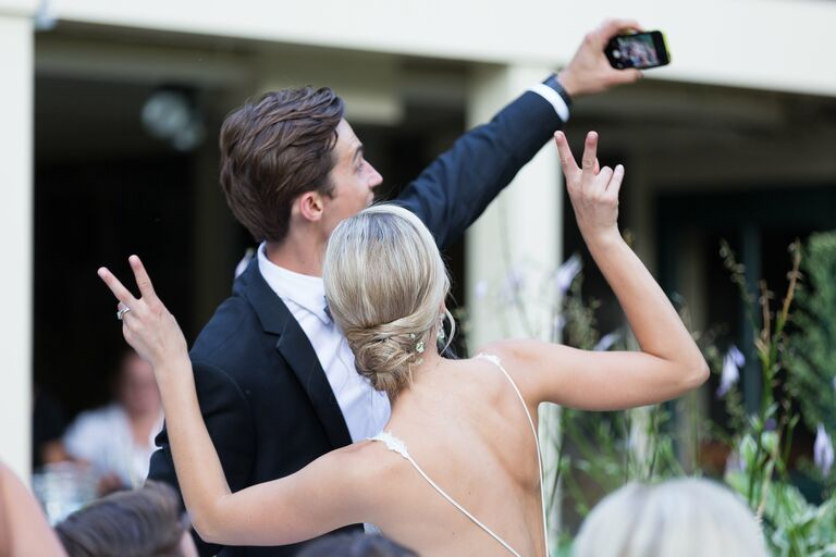Couple posing in front of an iPhone