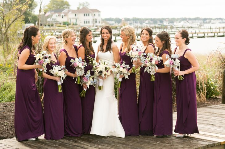 """I wanted them to be comfortable since it was going to be a long day, and the Jersey-style dress seemed like the right choice,"" Caitlin says of her merlot colored Amsale bridesmaid dresses."