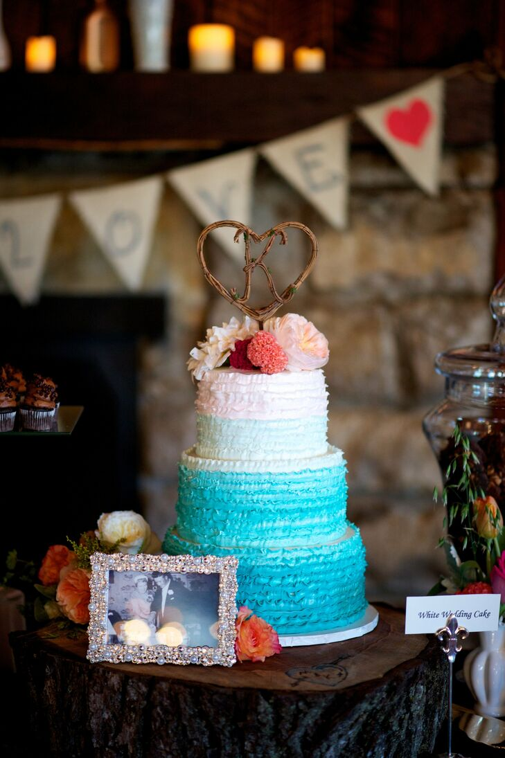 The couple's three-tier turquoise ombre cake had ruffled buttercream frosting.