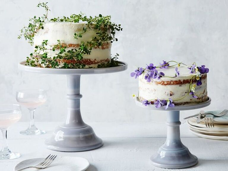 Pale pastel tall wedding cake stand in smaller and larger size with pretty floral decorated cakes