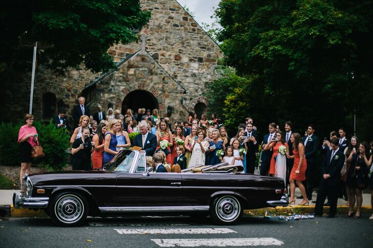 """Of course, Cam and Mike's classic wedding came with a chic exit. She drove with her uncle to the church in her grandfather Murphy's 1961 Mercedes convertible. After she and Mike exchanged vows, the vintage car became their exit ride. """"Riding in that car to and from the ceremony was one of my favorite parts of the day,"""" Cam says."""