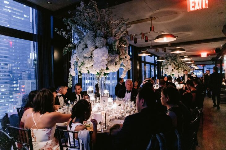 Restaurant Reception with Tall Flower Centerpieces