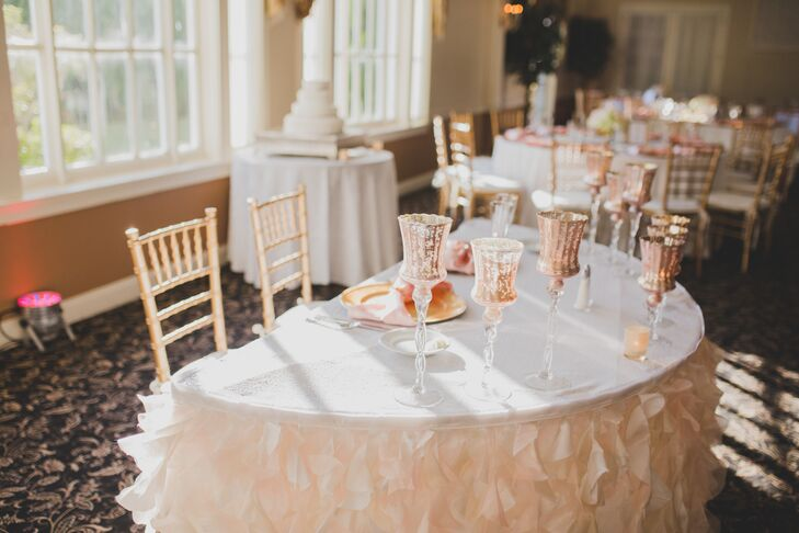 "Though Christina and Darnel didn't pinpoint a specific theme for their wedding, their soft blush, ivory and gold palette gave the day an undeniably romantic feel. ""We're not over-the-top people in general, so it fit us perfectly,"" Christina says. From the flowers to the linens and the decadent dessert display, the palette was incorporated into every element, giving the day a cohesive feel."