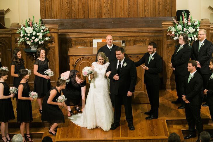"""Ginnie and Tyler said """"I do"""" at First Presbyterian Church in Macon, Georgia. White and blush floral arrangements in decorative urns enhanced the wooden church backdrop."""