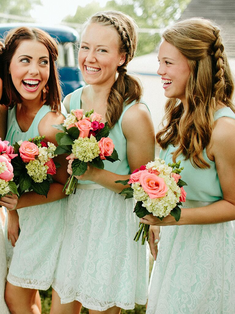 Half-up wavy bridesmaid hairstyle with a Dutch braid