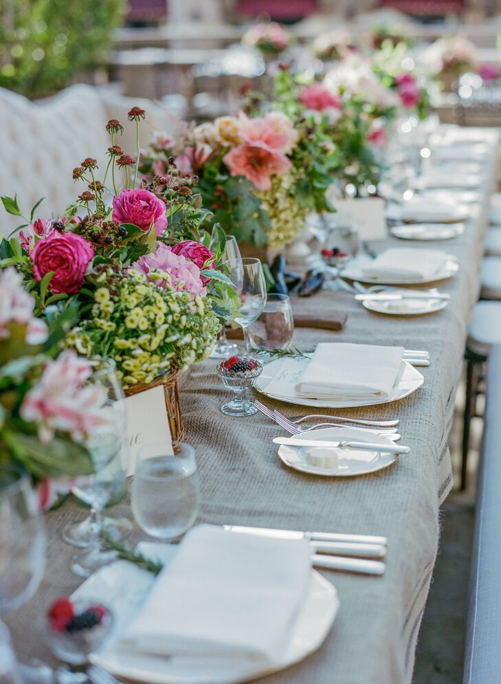 The reception centerpieces had a vibrant earthy vibe, with a bright mix of pink roses, peonies and flowers accented with seasonal fruits, berries and vegetables.