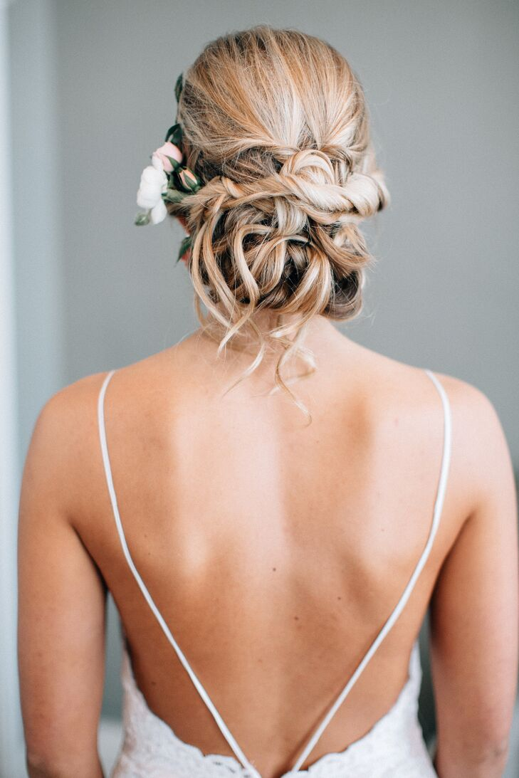 """""""My favorite part of the dress was the open back,"""" Ashley says. She wore her hair up in loose curls for a soft, romantic look."""