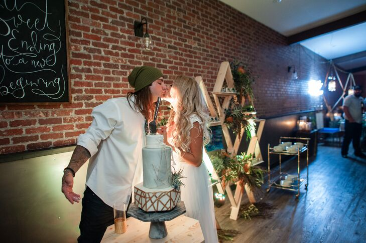 """Our cake was so cool,"" Christa says. ""It was three tiers with marble and gold accents, all vanilla filled under the most gorgeous fondant. We did not have a topper, but we did have the most amazing air plant on the side of the cake to add a spark of green."""