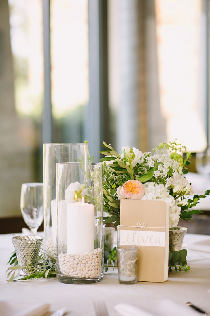 The floral arrangements were created with a natural, organic vibe. Kara and Justin wanted the design to have a vintage feel, so they chose lace runners to accent special tables like the sign-in table and the escort card table. Photo albums of the couple also served as a centerpiece.