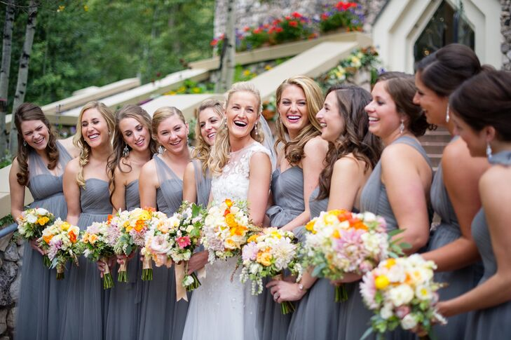 "The bridesmaids wore Jenny Yoo Annabelle dresses in sterling gray. ""The best part about the dress was that the girls could tie the sashes however they wanted,"" Liz says. ""So while everyone had the same dress, they could make it their own!"""