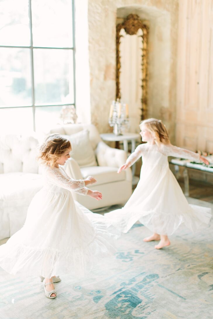 The two flower girls wore long bohemian-style ivory lace dresses and crowns of greenery in their hair.