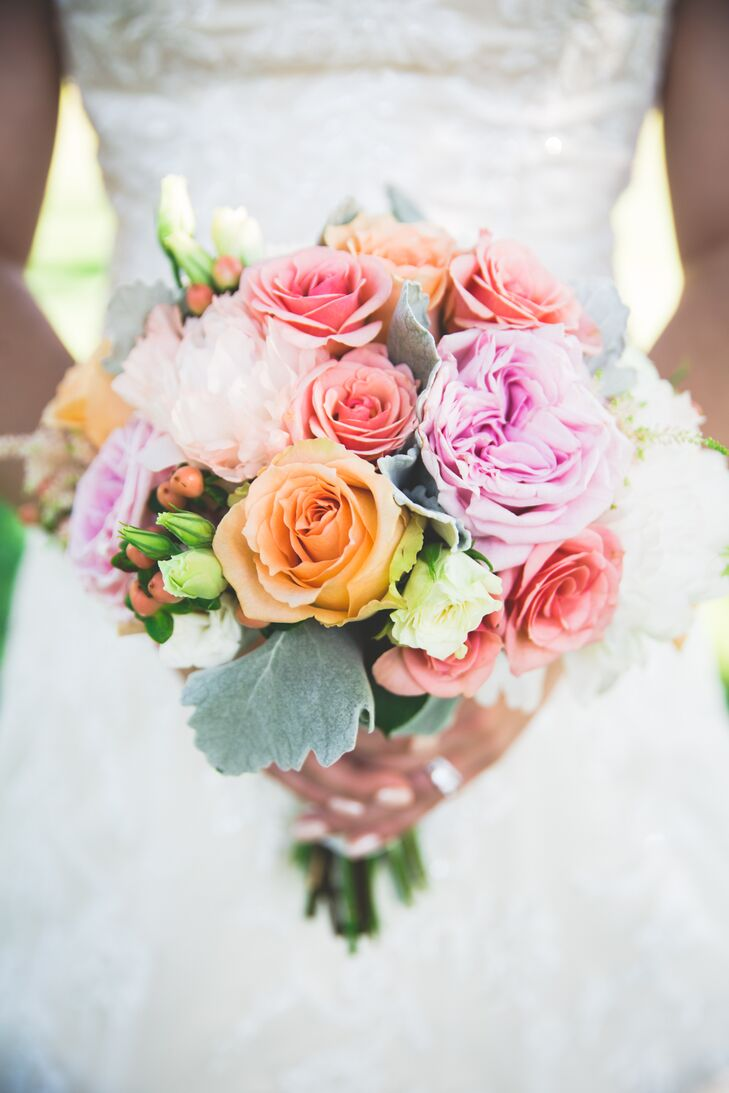 While the couple went for an understated aesthetic when it came to their decor to let the natural beauty of their venue shine through, Laura's bridal bouquet was bursting with color and vibrancy. Campbell's Floral Design filled the arrangement with spray roses, garden roses, peonies and dusty miller in bright, cheerful shades of peach, pink, blush and white.