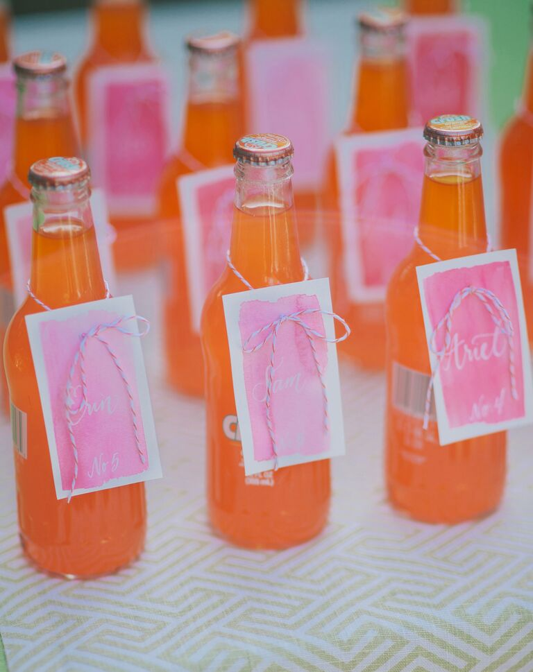 Orange soda with watercolor escort card