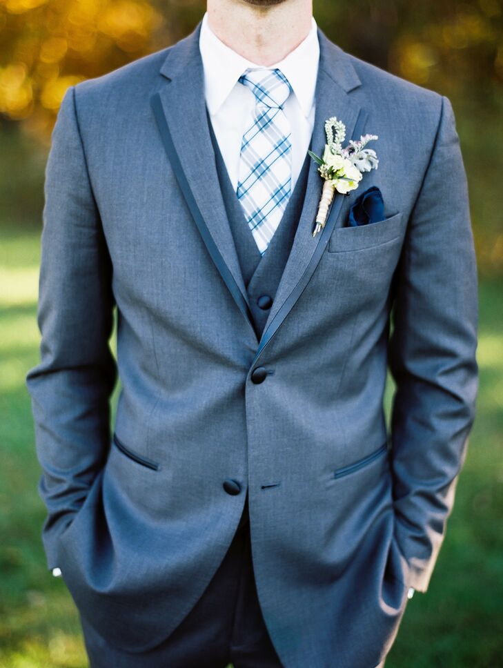 The groom wore a gray tuxedo from Men's Wearhouse with a blue plaid tie.