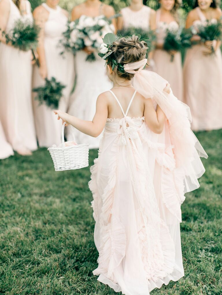 Flower girl in bohemian pink dress with bridesmaids