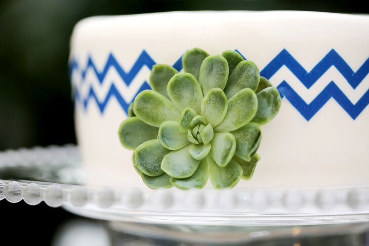 """We used small cakes on each table adorned with blue chevrons and accented with a succulents as our centerpieces,"" Courtney says. Each cake, made by Salt City Bakery in Utah, was set on a lighted stand."