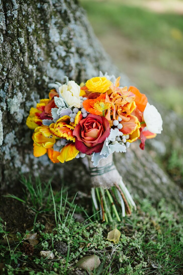 All nine bridesmaids held vivid bunches of silver brunia, dusty miller, Mokara orchids, ranunculus and roses in the day's colors.