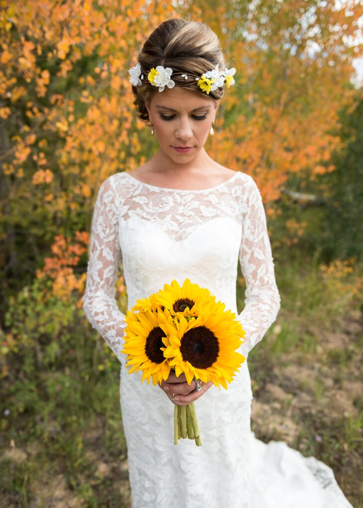 "Jenn wore a Maggie Sottero lace wedding dress with long sleeves. ""I was going for a flower child vibe,"" she says."