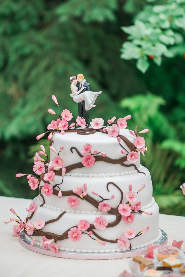 The three tier white cake had sugar pink flowers wrapped around the layers.
